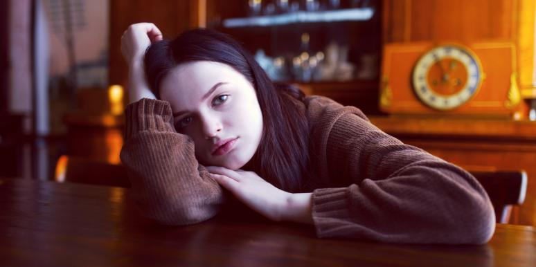 exhausted woman in sweater