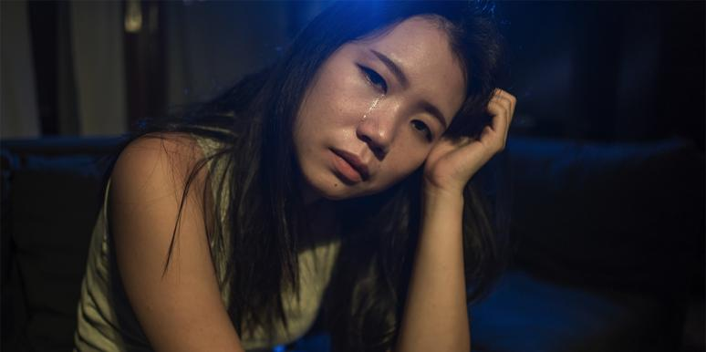 sad Asian woman crying