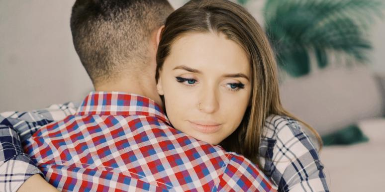 troubled woman hugging man