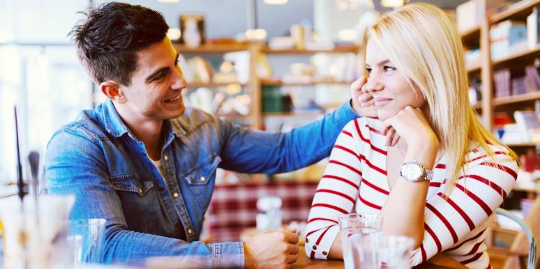 smiling man and woman flirting