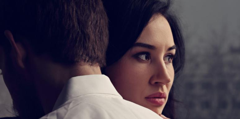 worried woman hugging man