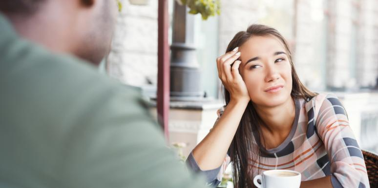 unhappy woman looking at a man across a table