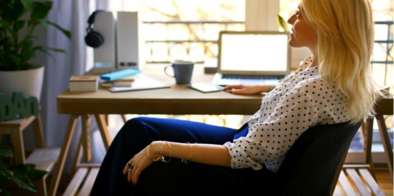woman sitting at an office desk