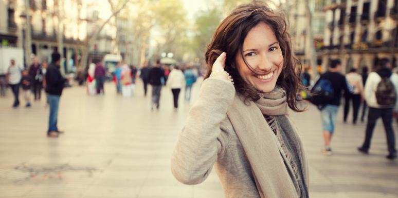 smiling woman in a scarf and sweater