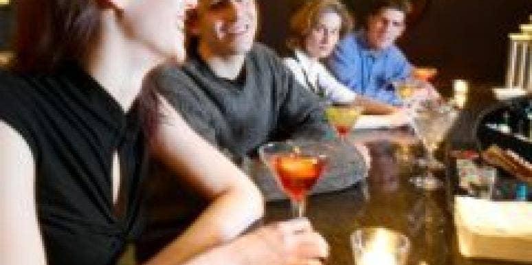 jealous judgmental couple friends socializing in bar