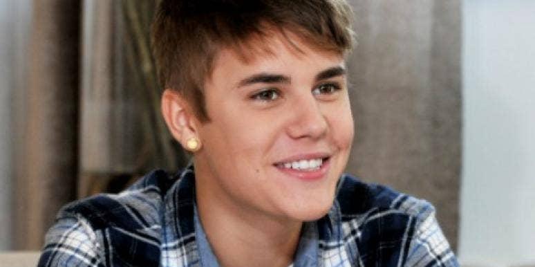Justin Bieber smiling in plaid