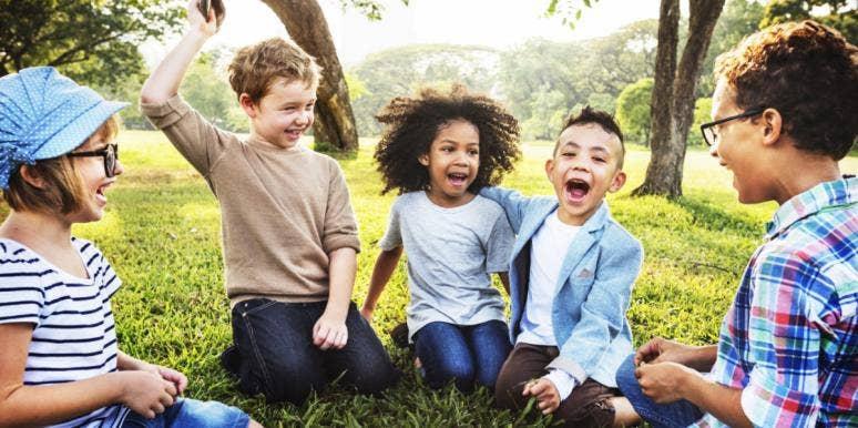 kids smiling in a circle playing