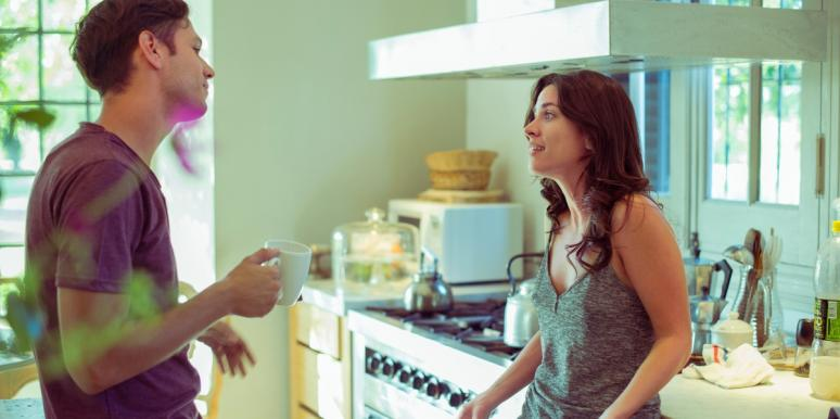 man and woman talking in a kitchen