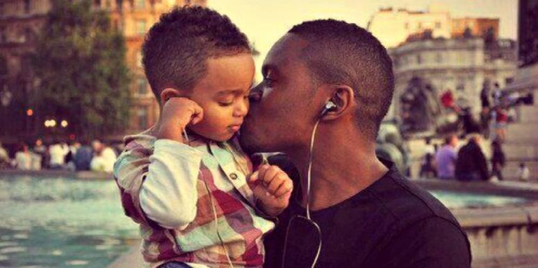 father kissing his son