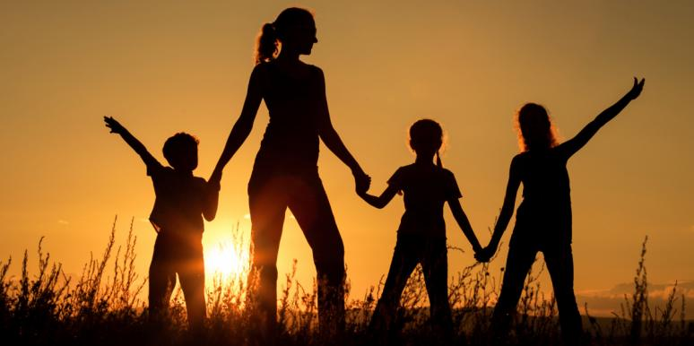 mom with three kids silhouette