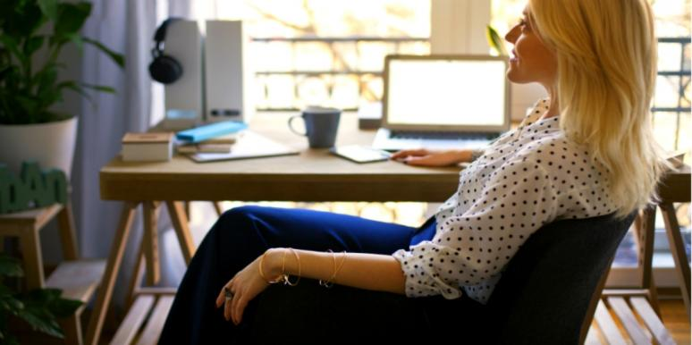working woman sitting at her desk