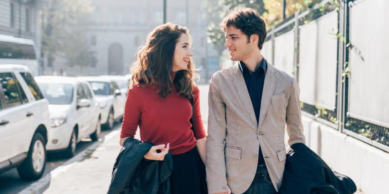 man and woman talking on date