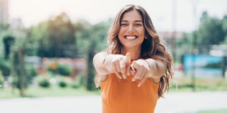 woman smiling and pointing