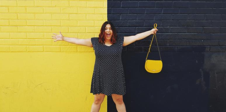 woman standing in front of black and yellow wall