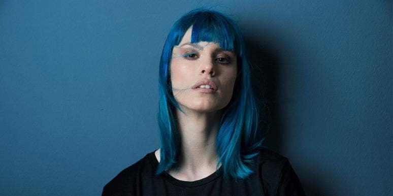 woman with blue hair sad upset