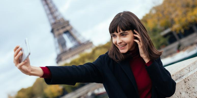 woman taking selfie with eiffel tower