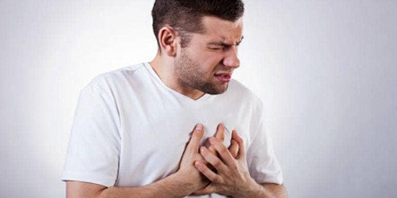 man grasping at his heart