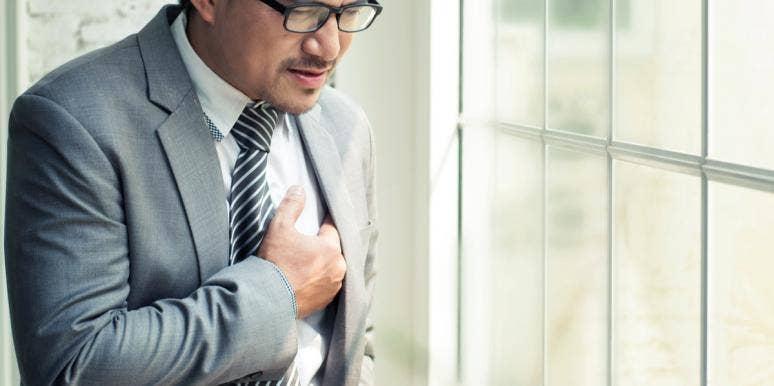 Businessman having a heart attack