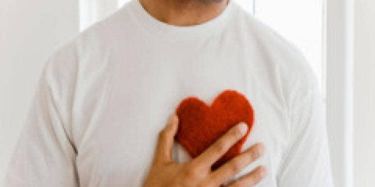 man holding felt heart