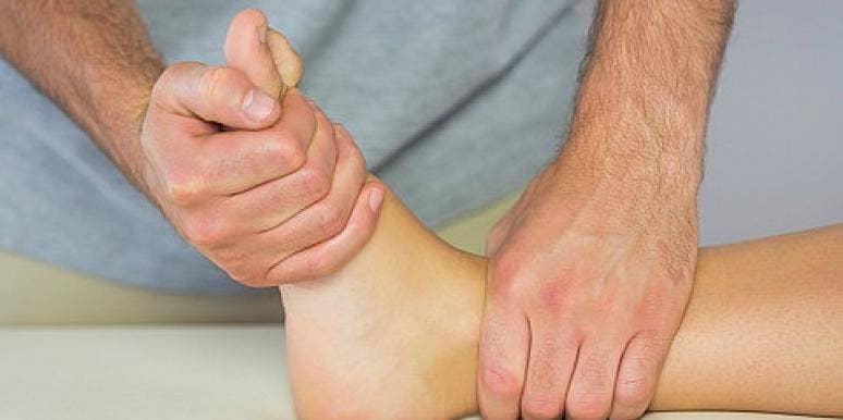 man massaging feet