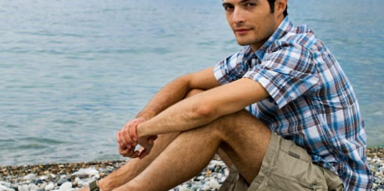 man sitting by the water