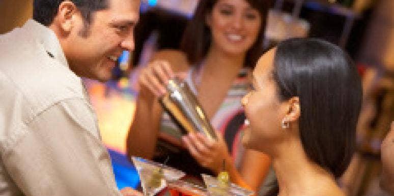 man talking to woman at bar