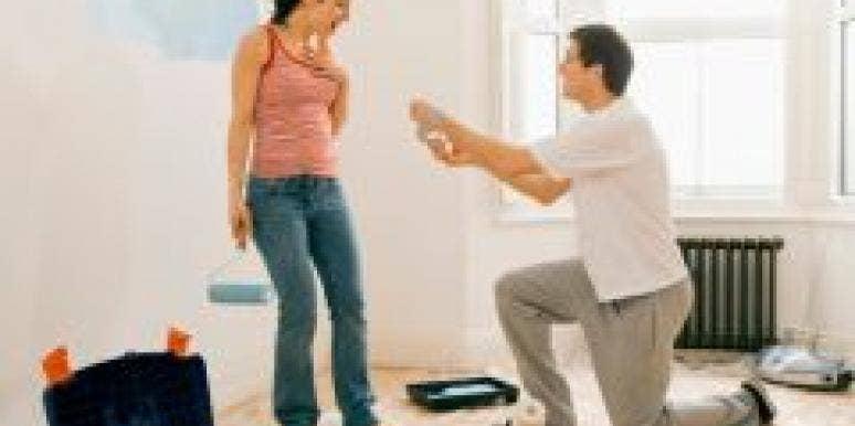 man kneeling before woman