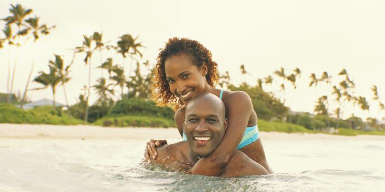 man and woman swimming in the ocean