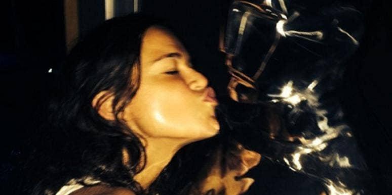 Michelle Rodriguez kissing a camera