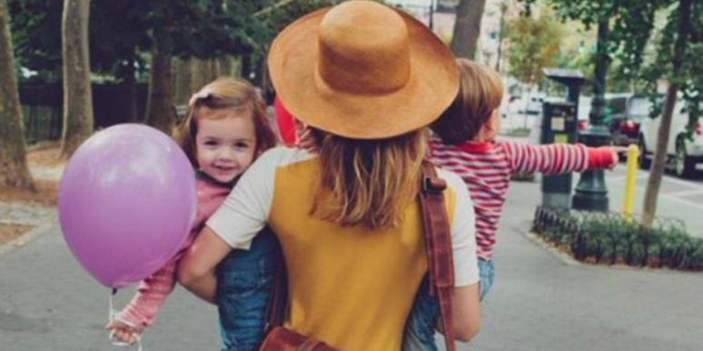 mom holding kids