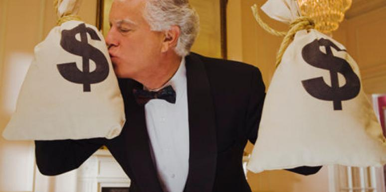man kissing money