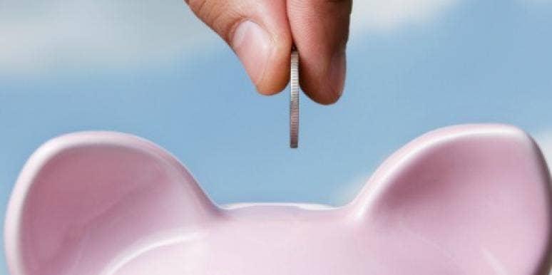 adding money to a piggy bank