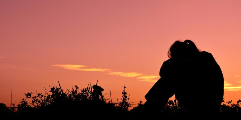 silhouette of woman in sunset
