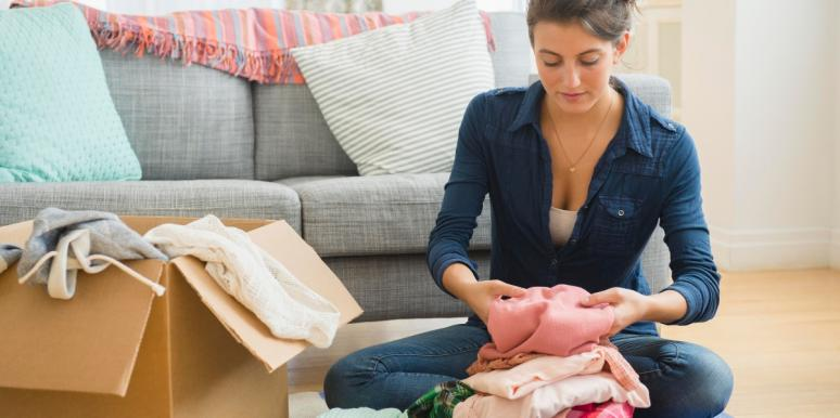 woman packing clothes in a box