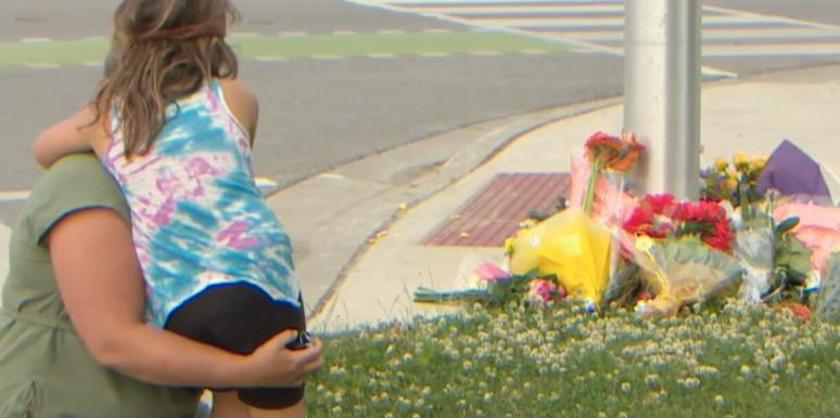 Visitors bring flowers to the site of the attack
