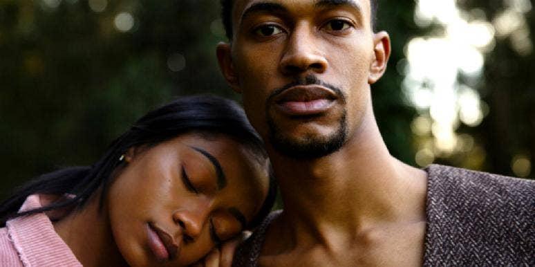 girlfriend resting her head on her boyfriend's shoulder