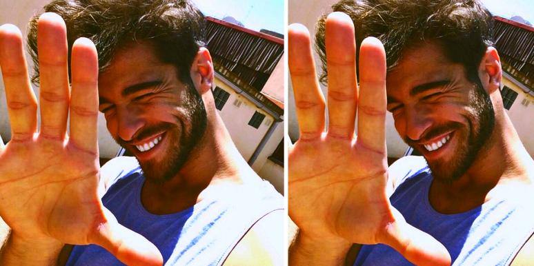 man holding up hand