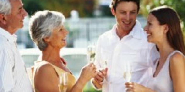 older and younger couple enjoying champagne