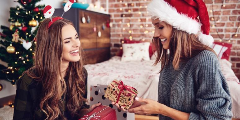 women exchanging gifts at Christmas