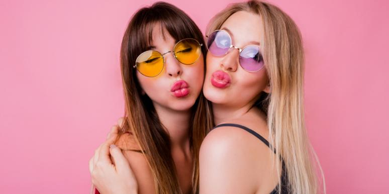 two best friends making kissing face wearing sunglasses