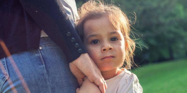 little girl holding her parent's hand