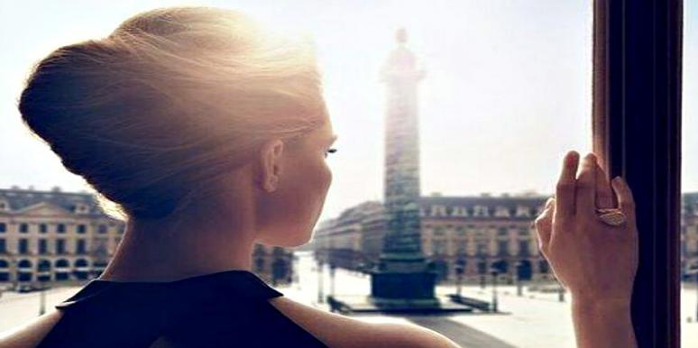 woman looks out at world