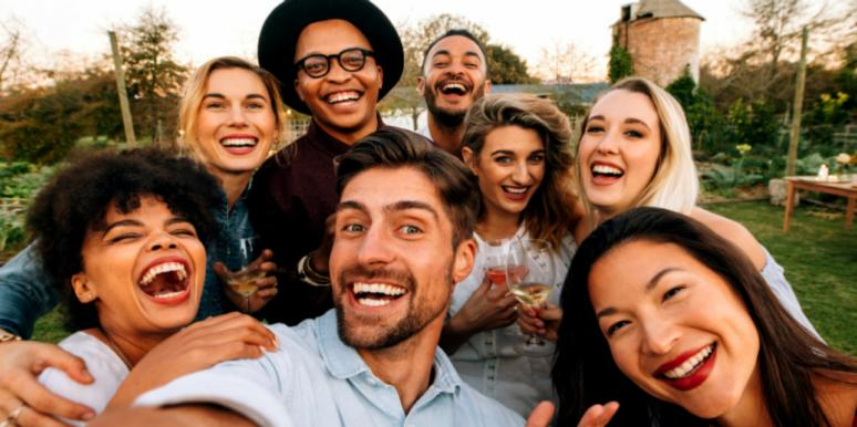 group selfie smiling laughing friends