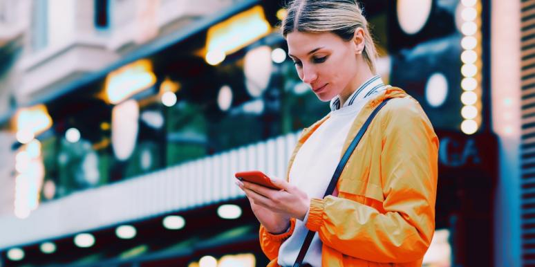 woman in orange texting