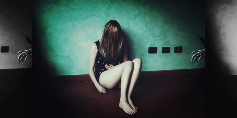 sad girl sitting in corner