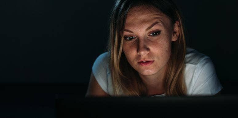 woman on laptop at night
