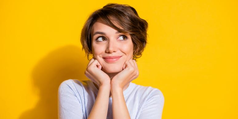 smiling woman on a yellow background