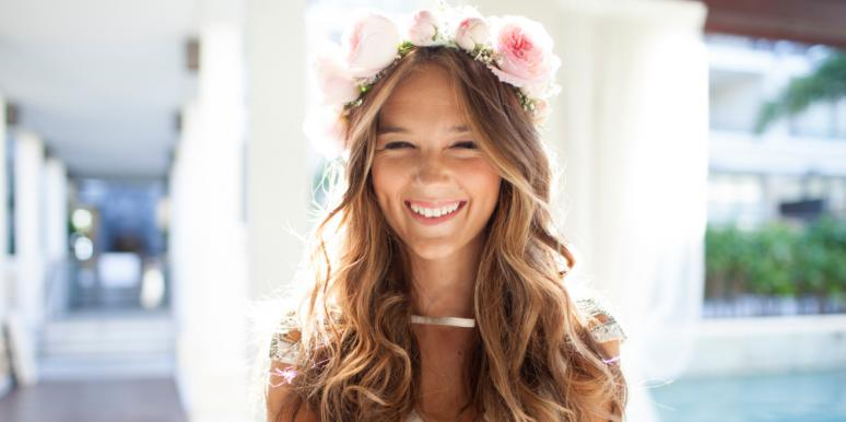 woman with flower crown smiling