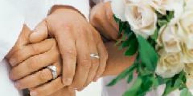 couple getting married holding hands