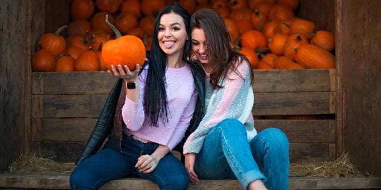 girls at a pumpkin patch